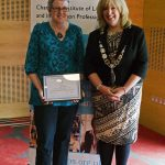 Anabel Marsh receiving honorary membership from CILIPS President Audrey Sutton