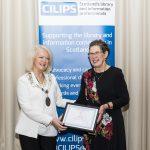 Elspeth Scott receiving honorary membership from CILIPS President Liz McGettigan