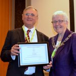 Guy Daines accepting his honorary membership certificate from CILIPS President Margaret Menzies