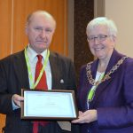 Ian McCracken accepting honorary membership from CILIPS President Margaret Menzies
