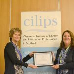 Jenny Des Fountain receiving honorary membership from CILIPS President Theresa Breslin