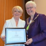 Liz McGettigan accepting honorary membership from CILIPS President Margaret Menzies