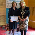 Rosemary Goring receiving honorary membership from CILIPS President Audrey Sutton