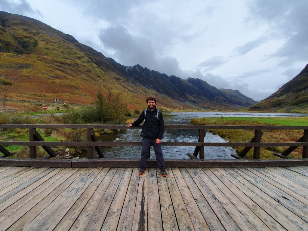 Luca standing on a bridge in Geln Coe, Scotland
