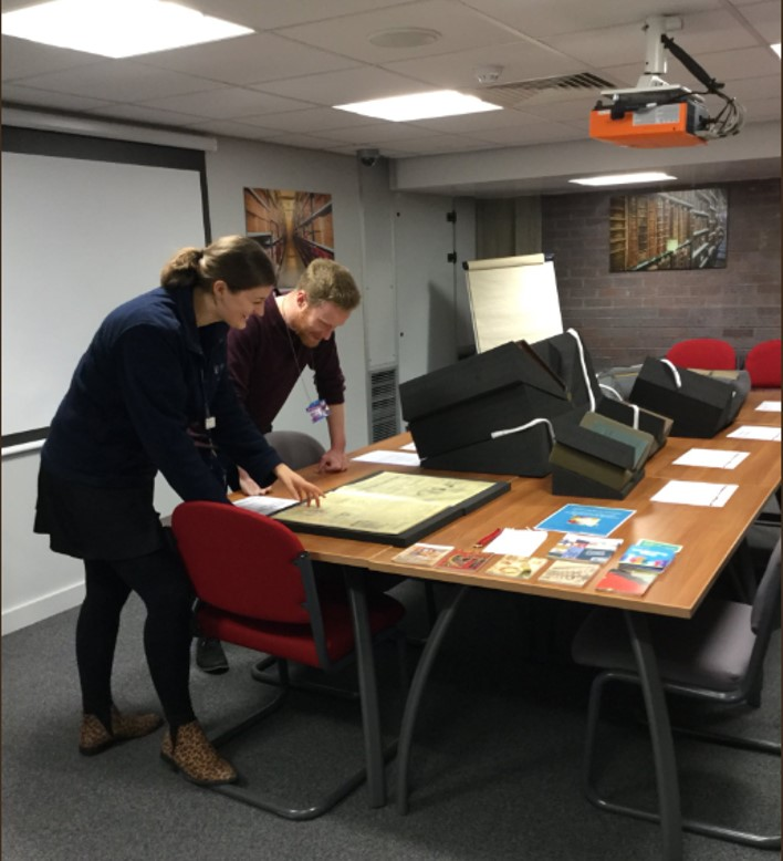 Robyn Orr in her role as a Library Assistant, helping somebody to use Special Collections material