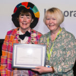Yvonne Manning presents Carole Gray with Honorary Membership award