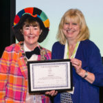 Yvonne Manning presents Fiona Clark with Honorary Membership Award
