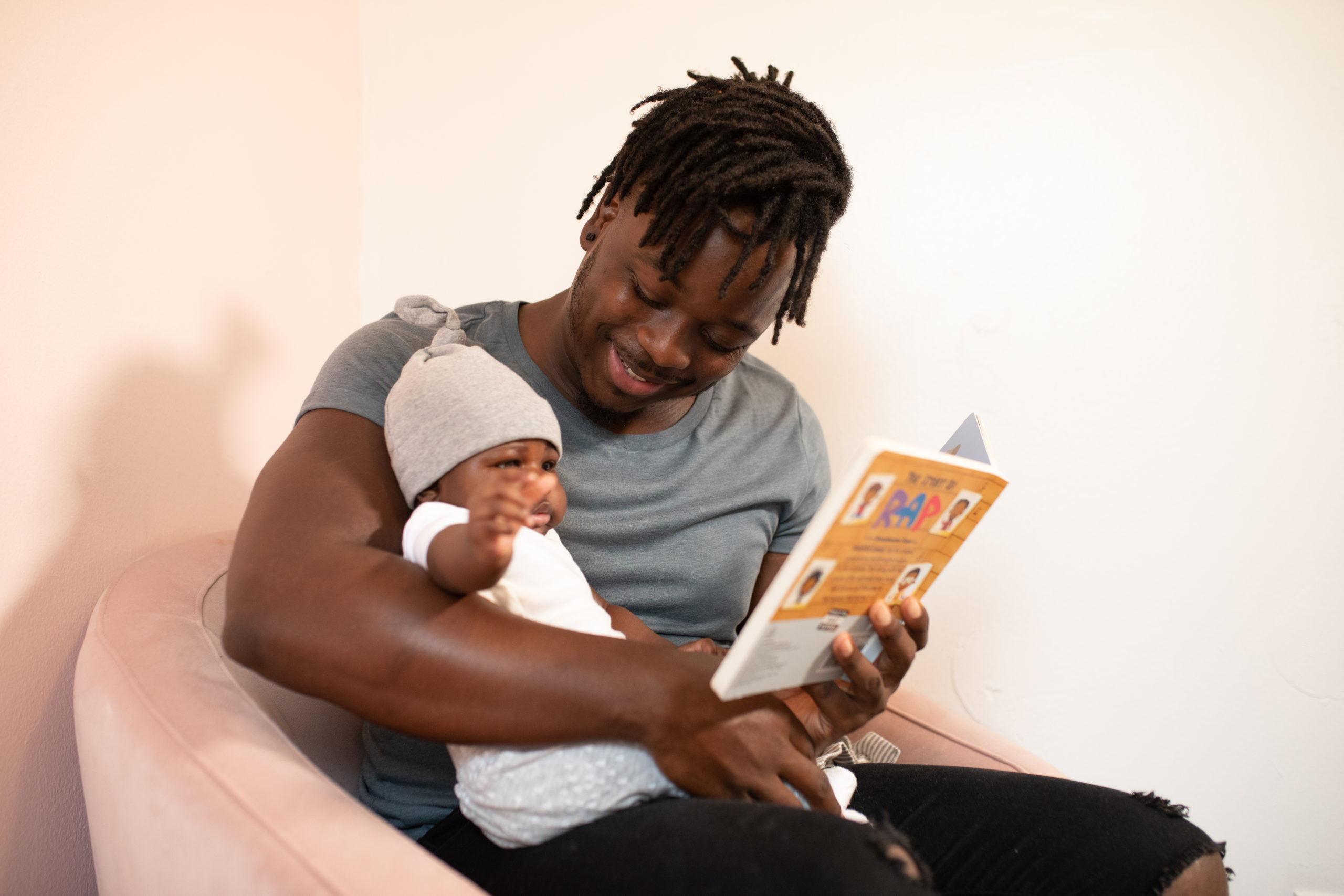 a father sharing a picture book with his young child